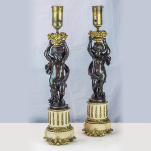 Pair of French Patinated Bronze and Gilt Metal Figural Lamps