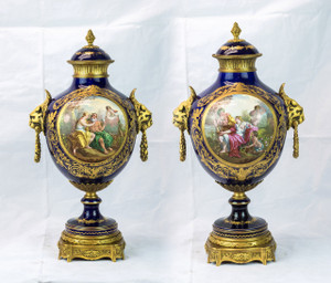 An exquisite pair of Sevres style ormolu mounted, cobalt blue, porcelain vases with lion mask handles
