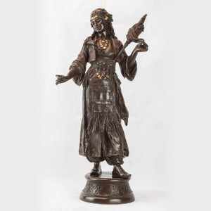 A fine patinated bronze sculpture of an Orientalist dancing girl by Émile Guillemin