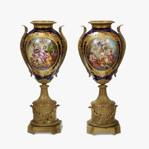 An Important Pair of Monumental Sèvres style Ormolu mounted and Cobalt Blue Painted Porcelain Urns