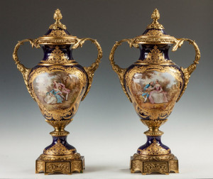 A Fine Pair of Sevres Style Porcelain Cobalt Blue Covered Urns with Courting Couples and Landscapes.