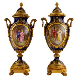 An Important Pair of Sèvres Ormolu Mounted Cobalt Blue Vases and Covers.
