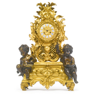A 19th Century Napoleon III Gilt and Patinated Bronze Mantle Clock