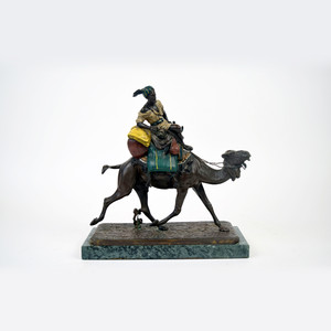 A Fine Cold Painted Austrian Bronze Figure of an Arab Riding a Camel by Franz Bergman