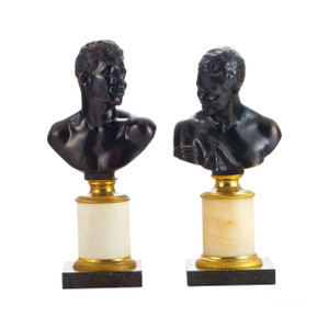 A Fine Pair of Patinated Bronze Busts of Nubians on Marble