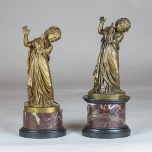 A Fine Pair of Italian bronze figure of a girl holding a dove by A. Messina