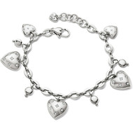 Sprinkled with glistening Swarovski stars, these heart charms shine delicately on this chain bracelet