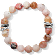 Symbolizing spiritual awakening and renewal, faceted opal beads in a pink hues encircle your wrist. On both sides, a tumble of mixed metal rings signals sleek sophistication.