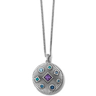 This petite medallion necklace sparkles with crystals in twilight hues, shining against a textured background. On its reverse, a single star shines. Petite, and great for layering.