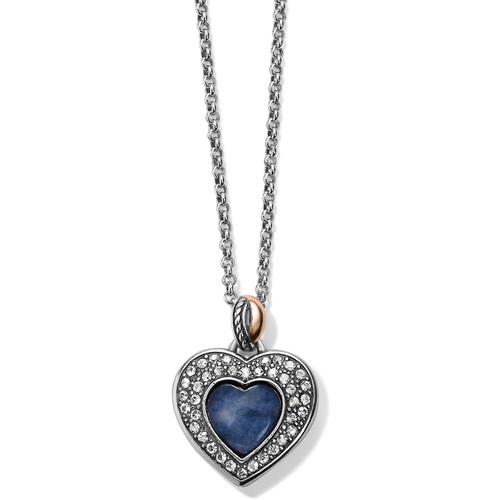 This reversible heart necklace features Brazil Blue Quartz on one side, showcased in a framework of pave Swarovski, while the other offers rose gold plating, surrounded by smooth silver. Blue quartz is said to promote soothing, calming feelings.