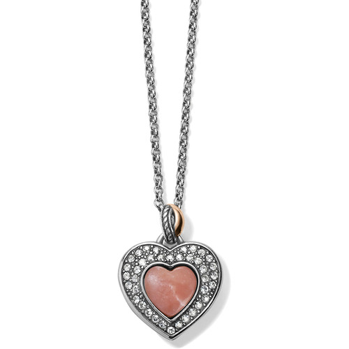 This reversible heart necklace features Pink Opal on one side, showcased in a framework of pave Swarovski, while the other offers rose gold plating, surrounded by smooth silver. Pink opal is said to promote spiritual awakening and renewal