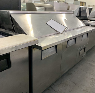 Mega Top Sandwich/Salad Unit, (30) 1/6 size (4''D) poly pans, (2) stainless steel insulated covers, 8-7/8''D cutting board, stainless steel top, front and sides, aluminum back, (2) full doors, (2) drawers, (3) shelves, white aluminum interior with 300 stainless steel floor, 5'' castors, 1/2 hp, 115v/60/1-ph, 10.3 amps, 7| cord, NEMA 5-15P, cUL, NSF-7, CE, MADE IN USA.