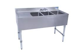 "NEW - Underbar Sink, three compartment, 48ƒ?W x 21-1/4""D x 32-1/2""H, 18/304 stainless steel construction, 10"" wide x 14"" front-to-back x 10"" deep compartments, 13-5/8ƒ? stamped drainboard on left OR right, 4-1/2""H backsplash, 4"" O.C. deck mount lead-free faucet (BKD-10-G), stainless steel apron on front & sides, includes basket drains (BKDR-2) & removable overflow standpipes (BK-OT-15075), galvanized steel legs & adjustable side bracing, adjustable high-impact corrosion-resistant feet, NSF"