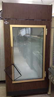 """Used-Leer ice freezer, single glass door merchandiser, wood grain exterior, white interior, 39""""W x 76""""H x 31""""D(+2"""" for door handle), 115 volts"""