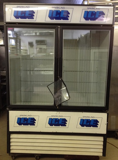 "Used-True Ice Merchandiser, two-section, (117) 8 lb. bag cap., white vinyl exterior, white interior with stainless steel floor, (2) floor racks, (2) glass hinged doors, interior lighting, leg levelers, 54""W x 79""H x 30""D (+2"" for handles), 1/2 HP, 115v/60/1, 10.2 amps, NEMA 5-15P, 9' cord, MADE IN USA"