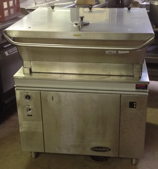 "Used-Cleveland Tilting Skillet, electric, 30-gallon capacity, modular enclosed cabinet base, standard with electric tilt mechanism, stainless steel construction, includes spring-assisted cover and gallon markings, level adjustable feet, 208 volts, single phase, 36""W x 43""H x 34""D"