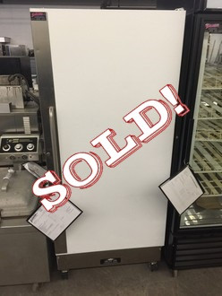 USED Arctic Air F22CWF4 Freezer, reach-in, one-section, 25.0 cubic feet capacity, (3) epoxy coated adjustable wire shelves, bottom mounted self-contained refrigeration, white painted steel front & sides, white ABS interior liner, casters, 115v/60/1, 7.0 amps, 3/4 hp, 9' cord, NEMA 5-15P, cETLus, NSF.