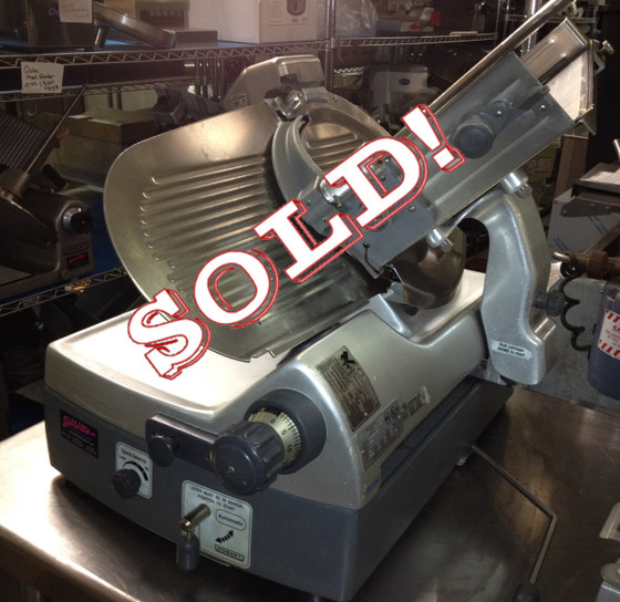 "Hobart Automatice Meat Slicer Model 2912 Specifications: Manufacturer: Hobart Model: 2912 Serial: Volts: 120 Amps: 5 Phase: 1 Dimensions: 29-1/4""W X 27-1/4""D X 27-3/4""H"