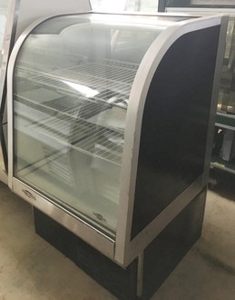 "FEDERAL Curved Glass Refrigerated Bakery Case, 31""W x 35""D x 48""H, self contained refrigeration with condensate evaporator, adjustable temperature control, curved thermopane front glass, top light (2) tiers of adjustable white wire shelves, glass swinging door, hinged left, white interior, tempered glass ends, laminate with black trim, designed for continuous lineups, 1/3 HP, UL, UL EPH CLASSIFIED. NBm."