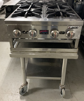 "Supreme™ Hotplate, countertop, gas, 24"", (4) 27,500 BTU burners, infinite manual controls, safety pilots, drip tray, stainless steel sides, front and plate shelf, 4"" adjustable stainless steel legs, 110,000 BTU, CSAus, NSF"