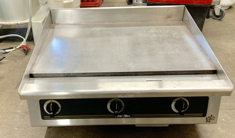 "USED 836T Griddle, countertop gas (propane), 36"" W x 24"" D cooking surface, 1"" thick T1 steel hexavalent chrome griddle plate, embedded mechanical snap-action thermostat every 12"", 4-3/8"" tapered wrap-around splash guard, 3-1/2"" front grease trough, heavy-duty metal knobs, standing pilot, welded steel frame with stainless steel exterior, 4"" stainless steel legs with 1-3/8"" adjustment, 90,000 BTU, cULus, UL EPH Classified, Made in USA"