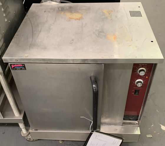 USED SOUTHBEND (MODEL: UNK) 1/2 SIZE CONVECTION OVEN. PROPANE. 115V. TEMPERATURE RANGE: 140-500 DEGREES.
