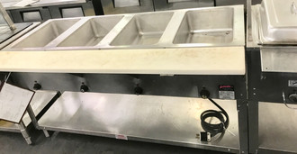 USED SUPREME METAL 345-93-E 4 WELL STEAM TABLE. 208V. 1 PHASE.