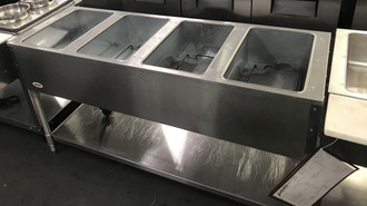 "USED EAGLE Hot Food Table, electric, 63-1/2""W, (4) 12"" x 20"" (dry) wells with infinite controls, stainless steel top, stainless steel undershelf & tubular legs, adjustable feet, 120v/60/1-ph, 2000w, 16.7 amps, NEMA 5-30P, UL, NSF"