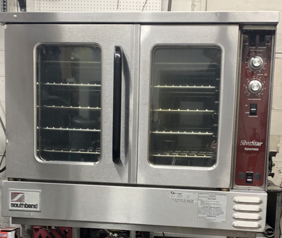 """USED SOUTHBEND SilverStar Convection Oven, gas, double-deck, standard depth, solid state controls, stainless steel front, top & sides, aluminized steel rear, 60/40 dependent doors, interior light, 6"""" stainless steel legs, 144,000 BTU, (2) 1/2 HP, CSA, NSF  LOCATED: NB"""