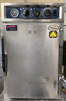 "USED ALTO-SHAAM Halo Heat Cook & Hold Oven, electric, low temperature, 40 lb. capacity - (4) 12"" x 20"" x 2-1/2"" full-size pans, simple controller with ON/OFF switch, heavy-duty stainless steel exterior, stainless steel side racks, (2) stainless steel wire shelves, (1) exterior drip tray with removable pan, 2-1/2"" casters; 2 rigid, 2 swivel with brake"