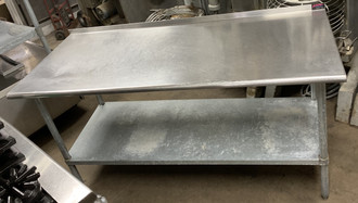 USED STAINLESS STEEL TABLE W UNDER SHELF & BACK SPLASH