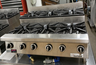 "USED GARLAND Step-Up Hotplate,  NAT gas, 36"", countertop, (3) 30,000 BTU open burners, (3) 30,000 BTU step-up open burners, manual controls, pilot lights, stainless steel front, sides and back, 3-1/2"" front rail, 4"" high adjustable legs, 180,000 BTU, CSA, NSF"
