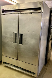 USED DELFIELD 2 DOOR, SOLID DOOR COOLER. 115V. 10 AMPS. 1/4 HP.