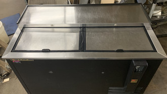 USED True Bottle Cooler, flat top, (16.5cs) 12oz bottles or (24cs) 12oz can capacity, stainless steel counter top & (2) lids, barrel locks standard, well design, galvanized interior, black powder coated exterior, (3) PVC coated adjustable bin dividers, LED interior lighting, bottle cap opener & cap catcher, R290 Hydrocarbon refrigerant, 1/5 HP, 115v/60/1, 1.9 amps, NEMA 5-15P, cULus, UL EPH Classified, MADE IN USA