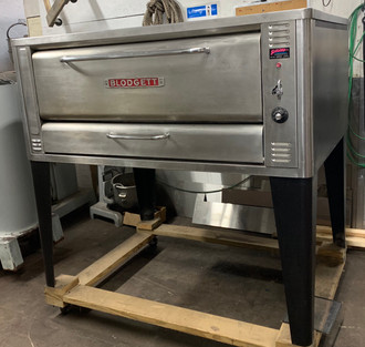 "used Pizza Oven, deck-type, propane gas, 48""W x 37""D deck interior, (1) 10"" high section, mechanical thermostat, spring assist door with concealed hinges, full angle iron frame, crown angle trim, stainless steel top, front and sides, 32"" stainless steel legs, 85,000 BTU"