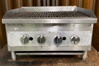 "USED VOLLRATH Charbroiler, LP gas, countertop, 24""W x 27""D x 17-1/2""H, radiant or lava rock setup, manual metal control knobs with knob guards, (4) burners placed every 6"", cast iron reversible top grates, 19"" cooking surface depth, 2-3/4""H backsplash & tapered sidesplashes, stainless burner construction, stainless & aluminized steel construction, 4"" adjustable legs, 80,000 BTU."