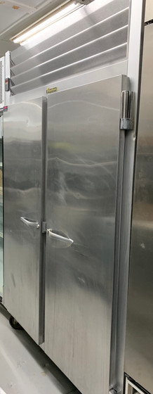 "Refrigerator, Reach-in, two-section, 46.02 cu. ft., self-contained refrigeration, (2) full-height solid doors (hinged left/right), (3) epoxy coated shelves per section (factory installed), stainless steel front, anodized aluminum sides & interior, microprocessor control with LED display, LED interior lights, 6"" high casters, non-flammable R-450A refrigerant, 1/3 HP, cETLus, NSF"