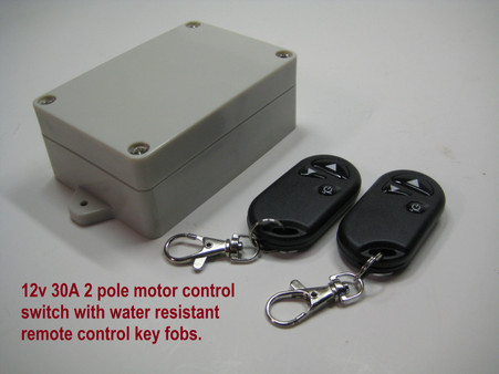 12V 30A reversible 2 pole motor control switch includes 2 water resistant remote control key fobs.