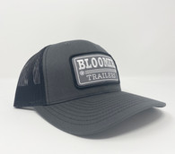 Charcoal front cap with black mesh back.  Patch is gray with black outline, white embroidery.  Richardson 112 cap.
