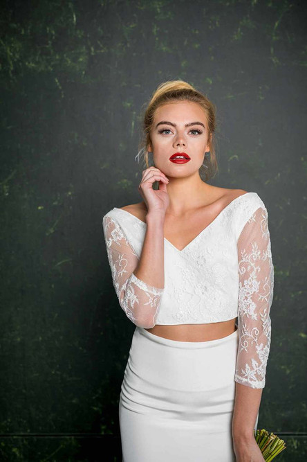 A soft V-shape at the front and back ensures you showcase that gorgeous décolletage whilst the traditional lace illusion sleeves nod towards 'classic' bridal. This new bridal top can be worn with all House of Ollichon skirts, trousers and culottes.