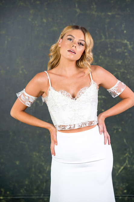 This pretty strappy top finds balance between structure and femininity. It is made with incredibly rare gold threaded bridal lace finished with a soft scalloped edge.