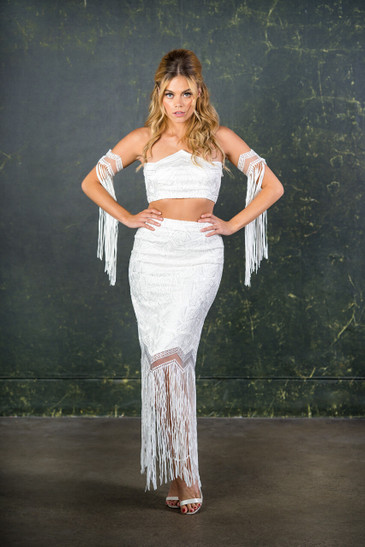 The epitome of modern day bridal. This exceptionally high quality, geometric bridal lace is at the forefront of all bridal trends. The flattering high waisted pencil skirt is completed with a dramatic tassel trim and geometric shaped bandeau top.