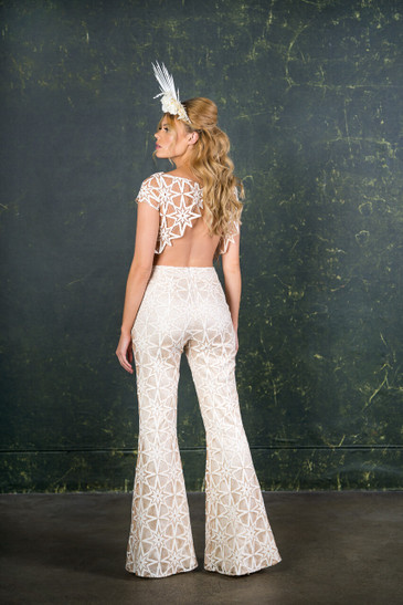 Channel your inner hippy with this gorgeous 70s inspired bridal two piece. This design comprises of high waisted bell flares and a star scalloped top lined with silk satin for a luxurious fit. Perfect for city weddings, festival weddings or to change into for party time.