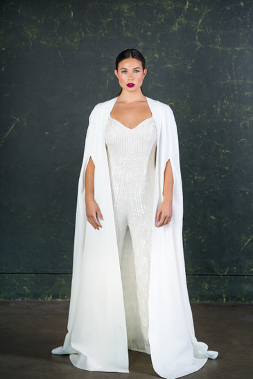 A stunning bridal cape made from heavy Italian crepe with slit arm holes for a sleek accessory to go with any bridal outfit.