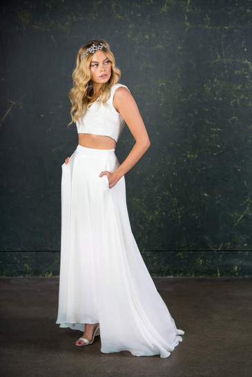 This beautiful, full-length bridal skirt is our most bridal of all of our two-pieces. Made with 100% silk crepe de chine with a 20cm puddle train to subtly sit behind you. Complete with our trademark pockets.