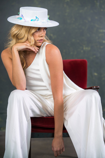 A one shouldered bridal jumpsuit made from incredibly soft sandwashed silk. The detachable frill gives a little extra detail but can be removed whenever you want. Pleated trouser legs add extra volume.