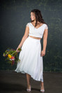 This classic beauty of a bridal skirt is a simple, modern and fun alternative to the wedding dress. The Thomas has a waterfall design so that the back slightly dips when compared to the front. Made with 100% silk over a heavy lining to give a fabulous shape and an incredible spin! The Thomas skirt features here with the Thomas top.