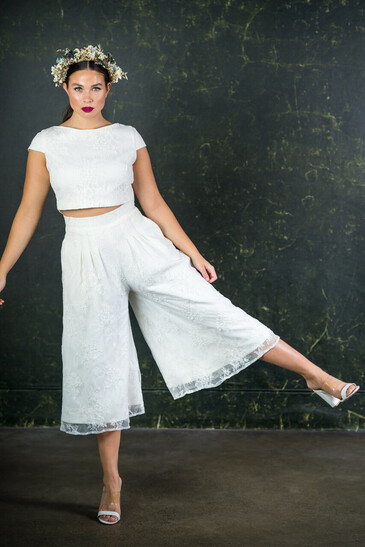 Made from stunning bridal lace with midi length trouser legs and cool pockets. This piece is such fun to wear and even better to dance in through your wedding night. The Drakeford culottes feature here with the Drakeford top.