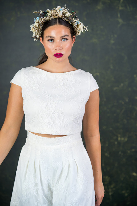 Capped sleeved bridal top has a flattering boat shaped neckline and invisible zip. A perfect, relaxed bridal top to twin with any bridal separate. The Drakeford top features here with the Drakeford culottes.