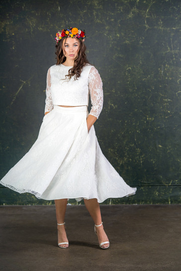 This beautiful bridal skirt is a modern and fun alternative to the big wedding dress while still offering a touch of tradition. The Le Fay has a waterfall design so that the back slightly dips when compared to the front. Made with a pretty, ivory lace laid over a heavy lining to give a fabulous shape and an incredible spin